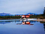 Lake Clark Air Service's de Havilland DHC3 Otter landing in the channel of Hardenburg Bay of Lake Clark, Port Alsworth, Alaska.