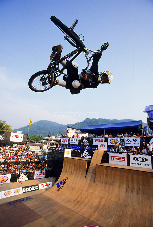 Professional BMX biker performing in the half pipe at the ESPN Asian X games Qualifier, Phuket, Thailand