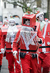 © under license to London News Pictures.  12/12/2010 Queesway, West London. Londoners dressed in Santa Claus costumes participate in 'SantaCon', a Santa-themed pub crawl across London yesterday (11/12/2010). Similar SantaCon events take place in various cities around the world, with an emphasis on having fun and spreading seasonal good cheer to passers by. Photo credit should read: London News Pictures