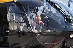 Prince George sits in a rescue helicopter as he visits Airbus in Hamburg, Germany with his parents and sister.