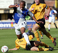 Fotball<br /> Foto: SBI/Digitalsport<br /> NORWAY ONLY<br /> <br /> Cambridge United v Bristol Rovers<br /> Coca-Cola Championship football league two<br /> Abbey Stadium 09/10/2004<br /> <br /> <br /> Bristol's Junior Agogo is tackled by Cambridge's Adam Tann for which he appealed as a foul.