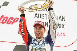 © Licensed to London News Pictures. 20/10/2012. Jorge Lorenzo (SPA) riding for the Yamaha Factory Racing raises his trophy after winning  during the Race day of the round 16 2013 Tissot Australian Moto GP at the  Phillip Island Grand Prix Circuit Victoria, Australia. Photo credit : Asanka Brendon Ratnayake/LNP