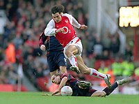 Robert Pires (Arsenal) Boudewijn Zenden (Midd). Arsenal v Middlesbrough. FA Cup 4th rd. 24/1/04. Credit : Colorsport/Andrew Cowie.