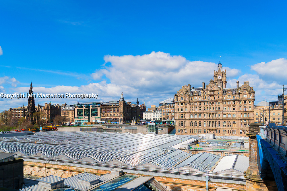 View of Balmoral Hotel on Princes Street and roof of Waverley Railway Station in Edinburgh, Scotland