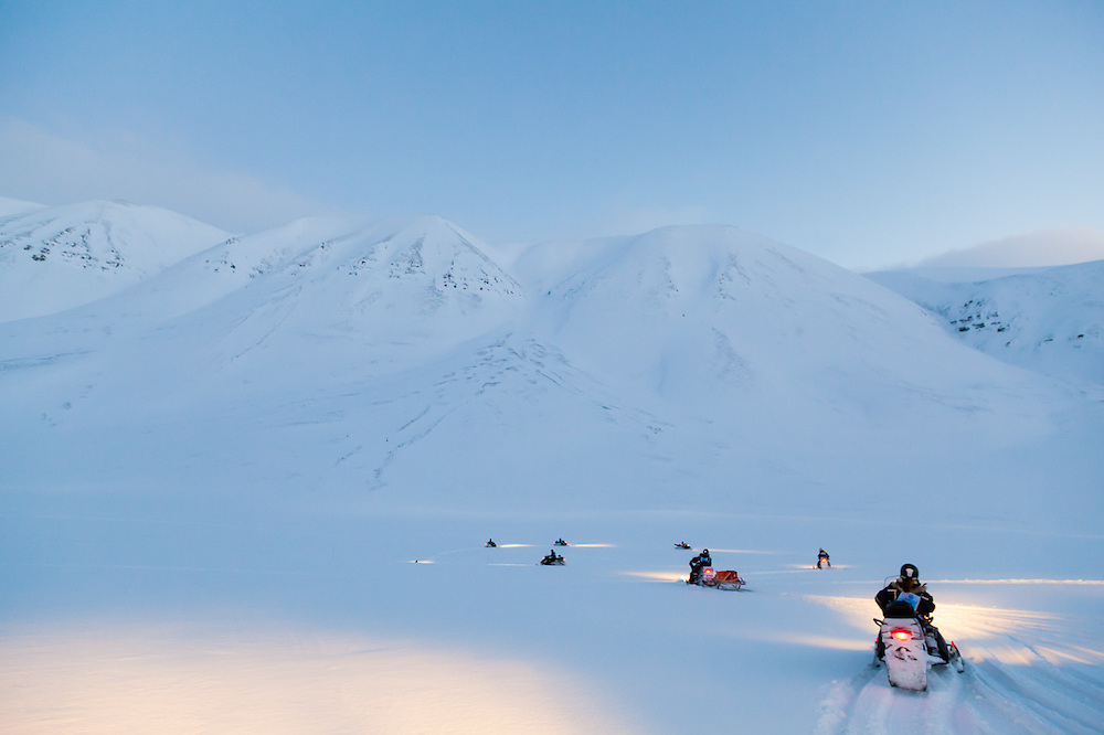 UNIS students practice driving their snowmobiles during a training course in Adventdalen, Svalbard.