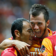 Galatasaray's Umut Bulut (L) with Emre Volak celebrating his goal and Kasimpasa's during their Turkish Super League soccer match Galatasaray between Kasimpasa at the TT Arena at Seyrantepe in Istanbul Turkey on Monday 20 August 2012. Photo by TURKPIX