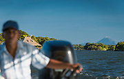 Landscape with view of Las Isletas Islands and a distant volcano from a motorboat, Lake Nicaragua, Granada, Nicaragua