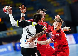 14.01.2021, 6th of October Sports Hall, Gizeh, EGY, IHF WM 2021, Österreich vs Schweiz, Herren, Gruppe E, im Bild Nicolas Raemy, Lukas Herburger, Sebastian Frimmel, // during the IHF men's World Championship group E match between Austria and Switzerland at the 6th of October Sports Hall in Gizeh, Egypt on 2021/01/14. EXPA Pictures © 2020, PhotoCredit: EXPA/ Diener/Eva Manhart<br /> <br /> *****ATTENTION - OUT of AUT and SUI*****