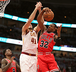 January 27, 2019 - Chicago, IL, USA - Chicago Bulls guard Kris Dunn (32) grabs a rebound against Cleveland Cavaliers center Ante Zizic (41) in the first half on Sunday, Jan. 27, 2019 at the United Center in Chicago, Ill. The Cavaliers defeated the Bulls, 104-101. (Credit Image: © Brian Cassella/Chicago Tribune/TNS via ZUMA Wire)