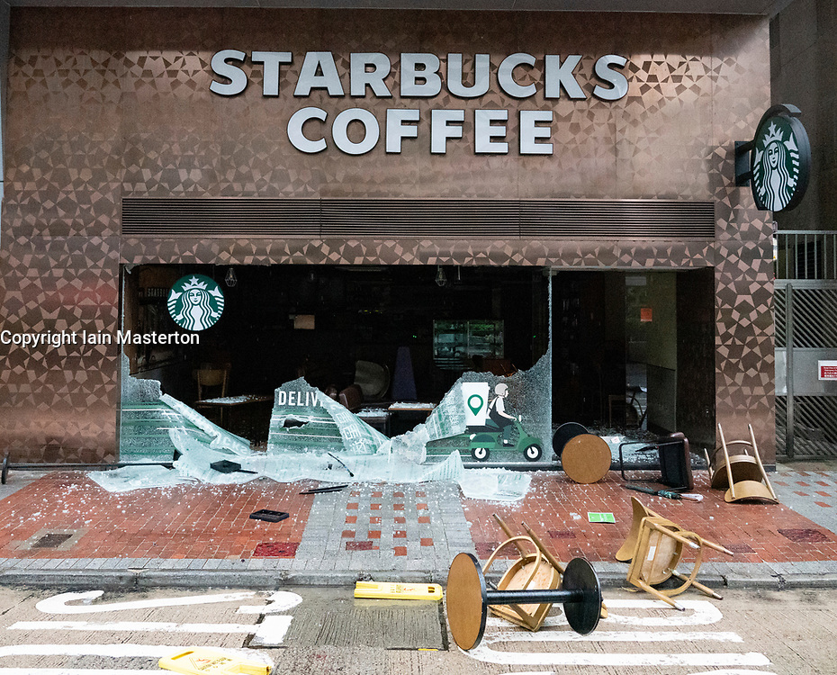 Hong Kong. 6 October 2019. Tens of thousands of pro-democracy protestors march in pouring rain through centre of Hong Kong today from Causeway Bay to Central. Peaceful march later turned violent as a hard-core of protestors confronted police. Pic; Pro-China franchise of Starbucks vandalised. Iain Masterton/Alamy Live News.