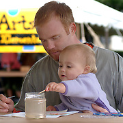 September 22, 2007 -- BRUNSWICK, Maine. Patrick Wright and his daughter Lilly, 2, of Woolwich work together on a watercolor at the 11th annual Family Arts Festival on Saturday, September 22. More than fifty local artists demonstrated and taught their skills to the community on the Mall in downtown Brunswick. Photo by Roger S. Duncan.