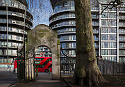 The Eastern gates of Battersea Park with the flats and apartments at the large Chelsea Bridge Wharf development on Queenstown Road, near Battersea Power Station, on 22 January 2018, in south London, England.
