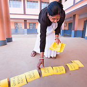 CAPTION: A trained ANM visits Bethany Convent School in Ratu, Ranchi, and teaches them on sexual and reproductive health through a game. The cards state the physical changes that occur for both boys and girls, and the boys are asked to segregate them by gender and put them in order. This is followed by a discussion. These sessions happen at the school biannually when the school health team visits. A lot more of this work is being done with girls as compared with boys. The reason is that for boys, suitable forums are not so readily accessible. For girls, there are the Mahila Samakhya schools and anganwadi centers. The latter come under the Government's Ministry of Women and Child Development. The School Health Program, however, is a component of the Adolescent Health Program, which gives importance to both boys and girls. Rashtriya Kishor Swasthya Karyakram (RKSK) (National Adolescent Health Program) was launched this year, doing peer interventions with both boys and girls. LOCATION: Bethany Convent School, Ratu (block), Ranchi (city), Jharkhand (state), India. INDIVIDUAL(S) PHOTOGRAPHED: Raj Kumari Sinha.