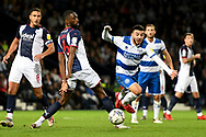 QPR midfielder Ilias Chair (10) sprints forward with the ball  under pressure from West Bromwich Albion defender Darnell Furlong (2) during the EFL Sky Bet Championship match between West Bromwich Albion and Queens Park Rangers at The Hawthorns, West Bromwich, England on 24 September 2021.