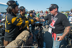 Shinya Kimura's Team 80 (Yoshimasa Niimi and Ayu Yamakita) celebrates after crossing the finish line at the end of Stage 16 (142 miles) of the Motorcycle Cannonball Cross-Country Endurance Run, which on this day ran from Yakima to Tacoma, WA, USA. Sunday, September 21, 2014.  Photography ©2014 Michael Lichter.