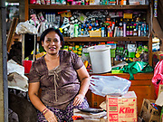 07 AUGUST 2017 - BEBANDEM, BALI, INDONESIA:  A shopkeeper in the market in Bebandem, in far eastern Bali. The market is known for baskets, which are woven in the area. Bali's local markets are open on an every three day rotating schedule because venders travel from town to town. Before modern refrigeration and convenience stores became common place on Bali, markets were thriving community gatherings. Fewer people shop at markets now as more and more consumers go to convenience stores and more families have refrigerators.    PHOTO BY JACK KURTZ