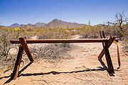 "03 MAY 2012 - VEKOL VALLEY, RURAL PINAL COUNTY, AZ:   Vehicle barriers on Bureau of Land Management land south of Interstate 8 and west of Casa Grande in rural Pinal County. The area has been a hotbed of illegal immigrant and drug smuggling for years. The BLM has undertaken a series of ""surges"" in the area, increasing their law enforcement patrols and partnering with Border Patrol and Pinal County Sheriff's Department officers to reduce criminal activity in the area. The BLM put in the vehicle barriers to stop immigrant and drug smugglers who were driving through the desert to reach Phoenix. Young said the barriers seemed to have worked because the number of vehicles recovered from the area is down substantially.      PHOTO BY JACK KURTZ"