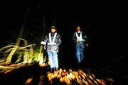 Yasuaki Komaya (L), 56, and Yasunobu Fujie (47) of a Yamanashi Prefectural patrol association check among the trees of Aokigahara Jukai, better known as the Mt. Fuji suicide forest, which is located at the base of Japan's famed mountain west of Tokyo, Japan on 02 Nov. 2009.