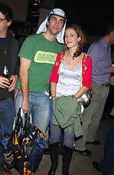 HUGH VAN CUTSEM and ROSE ASTOR at a fundraising party ay Umbaba nightclub, London on 5th April 2005 for Hugh Van Cutsem and brothers DOM and IAN ROBERTSON who intend to compete in the Marathon de Sables - 140 mile journey across the Sahara Desert in 7 days.  Money raised will go to their chosen charities the Fara Foundation and the Ian Maclay Leukaemia Trust.<br />