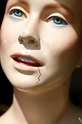 Close up of female face of mannequin dummy with crack running through it concept of stress