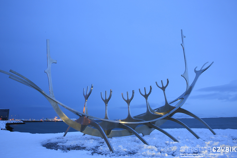 Sun Voyager - a massive steel sculpture by Jon Gunnar Arnason which may resemble a Viking ship, but is in fact a dream boat and ode to the sun and with a view of Mount Esja. Reykjavik, Iceland on March 8, 2014.<br /> <br /> copyright: Christina Czybik