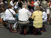 group of elderly people having lunch New York City