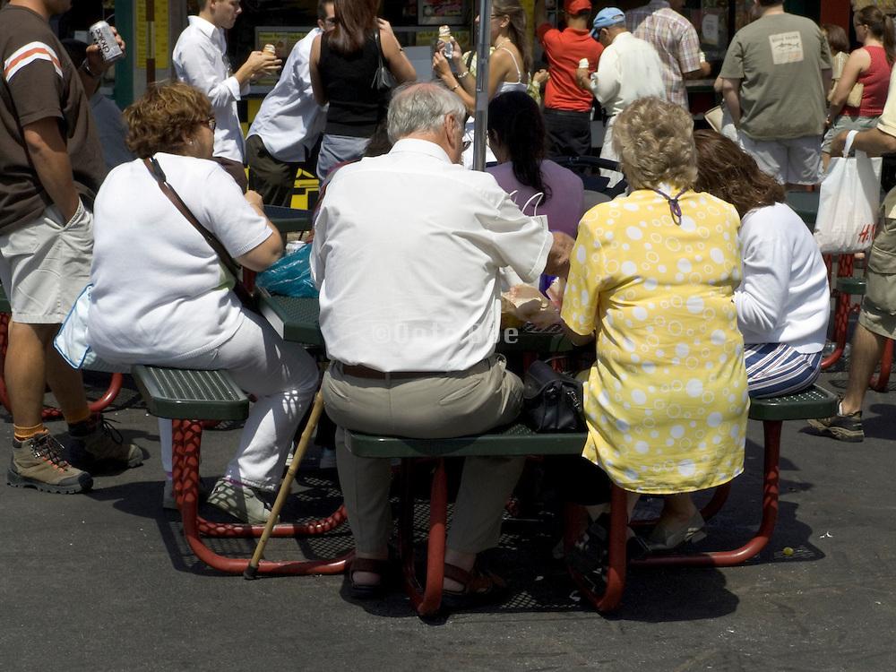 group of elderly people having lunch New York City