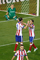 Atletico de Madrid´s Diego Godin celebrates a goal with Koke (R) in front of Malmo´s goalkeeper Olsen during Champions League soccer match between Atletico de Madrid and Malmo at Vicente Calderon stadium in Madrid, Spain. October 22, 2014. (ALTERPHOTOS/Victor Blanco)