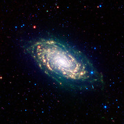 The various spiral arm segments of the Sunflower galaxy, also known as Messier 63, show up vividly in this image taken in infrared light by NASA's Spitzer Space Telescope.