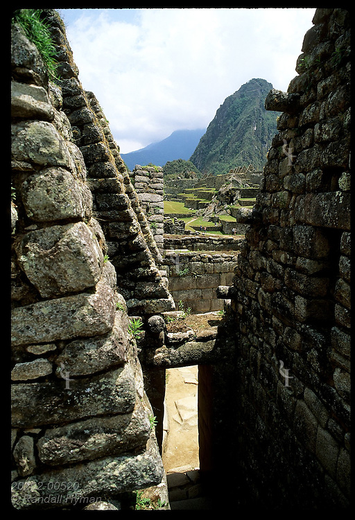 Huayna Picchu & east urban sector are framed by facades in west urban sector; (v) Machu Picchu. Peru