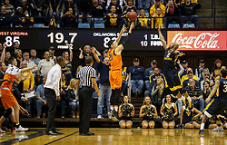 Feb 10, 2018; Morgantown, WV, USA; Oklahoma State Cowboys guard Lindy Waters III (21) shoots the go ahead three pointer late in the second half against the West Virginia Mountaineers at WVU Coliseum. Mandatory Credit: Ben Queen-USA TODAY Sports