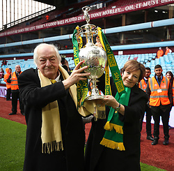 Norwich City's Majority Share Holders Michael Wynn-Jones and Delia Smith lift the Sky Bet Championship trophy at Villa Park in Birmingham.