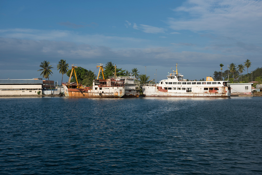 Vessels belonging to the bankrupt and shuttered company Lutheran Shipping sit idle and aging in the harbor at Madang, Papua New Guinea.