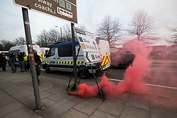 © Licensed to London News Pictures. 10/04/2018. Manchester, UK. Fans of Liverpool Football Club let off a flare as they arrive at the Etihad Stadium ahead of the Manchester City vs Liverpool Champions League quarter final match at the Etihad Stadium. Police have upgraded their operation covering the match after the Manchester City coach was attacked with flares and bottles by Liverpool fans, outside Anfield last week. Photo credit: Joel Goodman/LNP