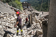 Firemen inspecting some destroyed building in the lower part of Pescara del Tronto where very few building are still standing
