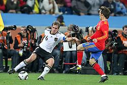 07.07.2010, Moses Mabhida Stadium, Durban, SOUTH AFRICA, Deutschland ( GER ) vs Spanien ( ESP ) im Bild Philipp Lahm ( FC Bayern Muenchen #16 ) gegen  DAVID SILVA ( Valencia (ESP) #21 ) Foto ©  nph /  Kokenge / SPORTIDA PHOTO AGENCY
