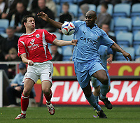 Photo: Lee Earle.<br /> Coventry City v Barnsley. Coca Cola Championship. 17/03/2007.Barnsley's Sam Togwell (L) battles with Dele Adebola.