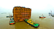 NANTONG, CHINA - JUNE 22: (CHINA OUT) <br /> <br /> The World's Largest Steel Open Caisson<br /> <br /> No. 28 steel open caisson gets transferred by tugboats on June 22, 2014 in Nantong, Jiangsu province of China. No. 28 steel open caisson, the world's largest steel open caisson with the weight of over 14,500 tons and the size of 86.9*58.7*44 meters, were transferred to the right place for construction in China's southeast city Nantong<br /> ©Exclusivepix
