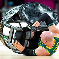 Groot-Brittannie, Londen, 05-09-2012.<br /> Paralympics.<br /> Rolstoelrugby, Mannen, Poulewedstrijd.<br /> Australie - Canada.<br /> Chris Bond van Australie is ondersteboven gekegeld door een canadees.<br /> Foto : Klaas Jan van der Weij
