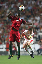 October 10, 2017 - Lisbon, Portugal - Portugal's midfielder William Carvalho (L) fights for the ball with Switzerland's defender Stephan Lichtsteiner (R ) during the 2018 FIFA World Cup qualifying football match between Portugal and Switzerland at the Luz stadium in Lisbon, Portugal on October 10, 2017. Photo: Pedro Fiuza  (Credit Image: © Pedro Fiuza/NurPhoto via ZUMA Press)