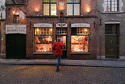 BRUGES, BELGIUM - DEC-30-2010 -  A pedestrian enters the 't Brugs Beertje, in Bruges, Belgium, considered by many beer aficionados as the best beer house in the world. (Photo © Jock Fistick)