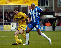 Photo: Olly Greenwood.<br />Colchester United v Burnley. Coca Cola Championship. 24/02/2007. Colchester's Chris Iwelumo and Burnley's Chris McCann