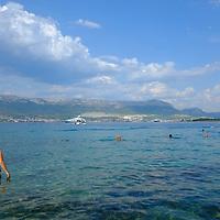 swimmer in the sea.<br />Beach bay,<br />Marjan Park, walk and swiming,<br />Split, Croatia. 2018