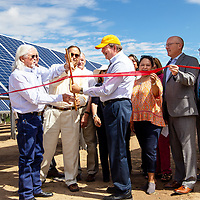 Mayor Jackie McKinney (left), previous city attorney George Kozeliski (center) and Electric Director Richard Matzke (right) cut the ribbon at the Allison Road Solar Park Tuesday morning.