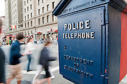 People rush by a Police Telephone near Union Square in San Francisco.