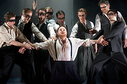 Don Giovanni<br /> by Mozart<br /> English Touring Opera<br /> at the Hackney Empire, London, Great Britain<br /> rehearsal<br /> 12th March 2008<br /> <br /> <br /> Roland Wood (as Don Giovanni)<br /> and Company<br /> <br /> Photograph by Elliott Franks