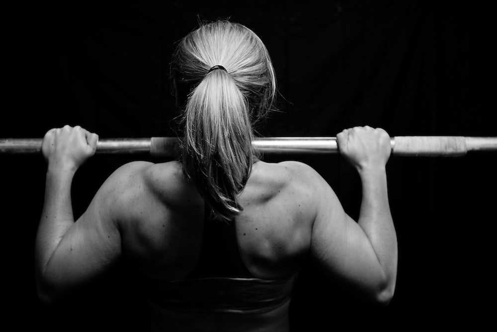 Andrea Hanley on the pull up bar at Progressive Fitness Crossfit