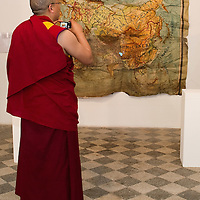"""VENICE, ITALY - JUNE 04:  A Tibetan Monk takes a picture of an installation by Ruggero Maggi at """"The Pavillion Tibet"""" a project by Ruggero Maggi on June 4, 2011 in Venice, Italy. The Venice Art Biennale will run from June 4 to November 27, 2011."""