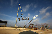 A light pole at the Rice ISD baseball practice field is bent in half, a result of the tornado that touched down the night before in Rice, Texas, October 25, 2010.  (Courtney Perry/The Dallas Morning News)