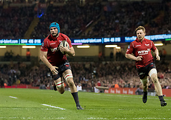 Scarlets' Tadhg Beirne breaks to score his sides third try<br /> <br /> Photographer Simon King/Replay Images<br /> <br /> Guinness PRO14 Round 21 - Dragons v Scarlets - Saturday 28th April 2018 - Principality Stadium - Cardiff<br /> <br /> World Copyright © Replay Images . All rights reserved. info@replayimages.co.uk - http://replayimages.co.uk